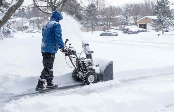 Photo of man shovelling snow
